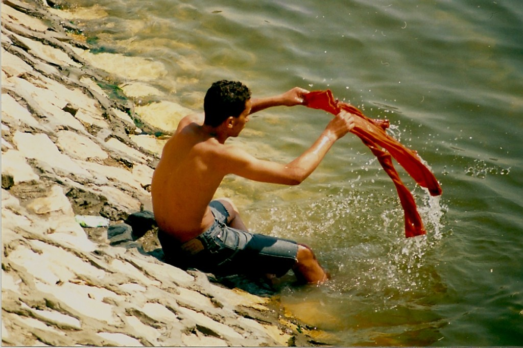 Washing clothes in River Nile